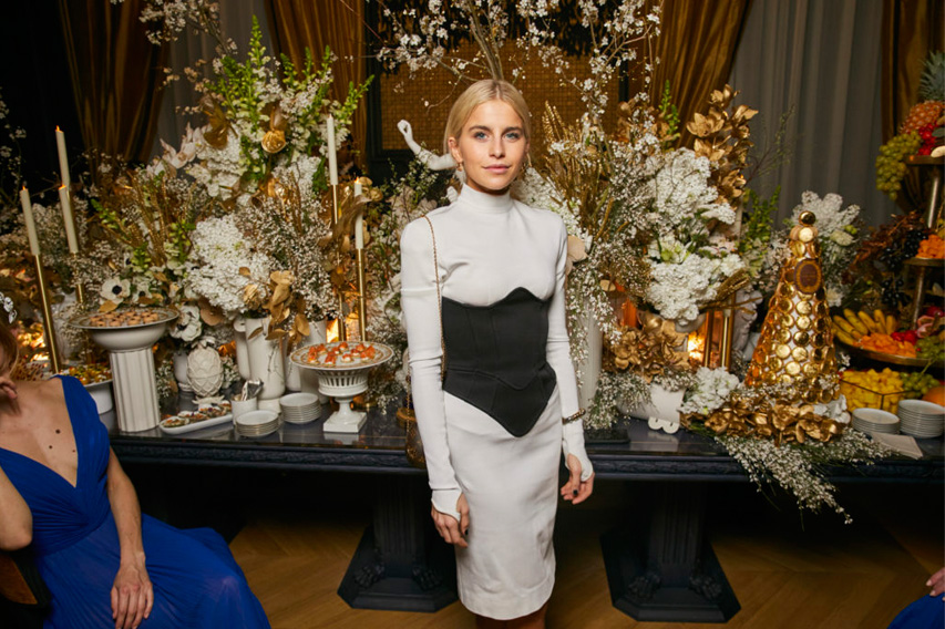 Caroline Daur attends the Chaumet reopening wearing a Louis Vuitton cocktail dress Perfect Wedding Magazine