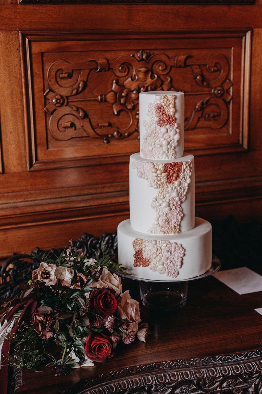 White fondant wedding cake by Sugarlily Cake in Perfect Wedding Magazine