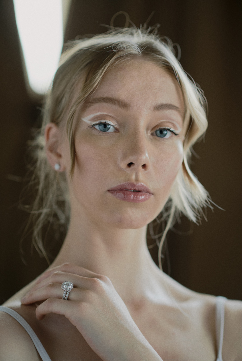 White bridal makeup featuring white eye-liner in Perfect wedding Magazine