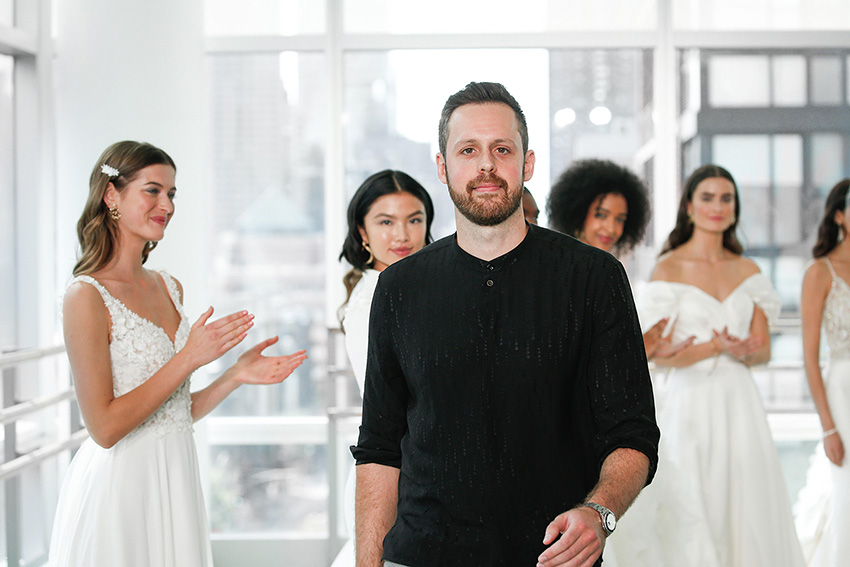 Fashion Designer Justin Alexander at New York Bridal Market featured in Perfect Wedding Magazine
