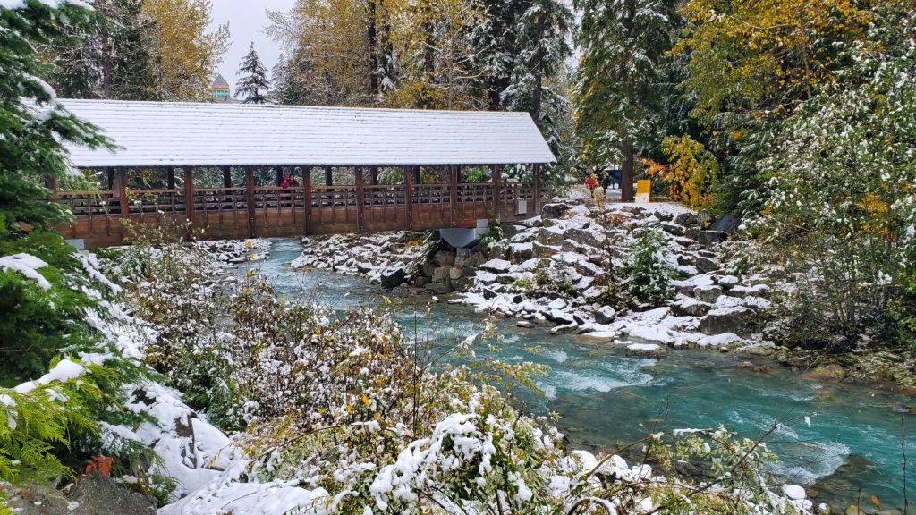 Whistler covered bridge over ice blue river