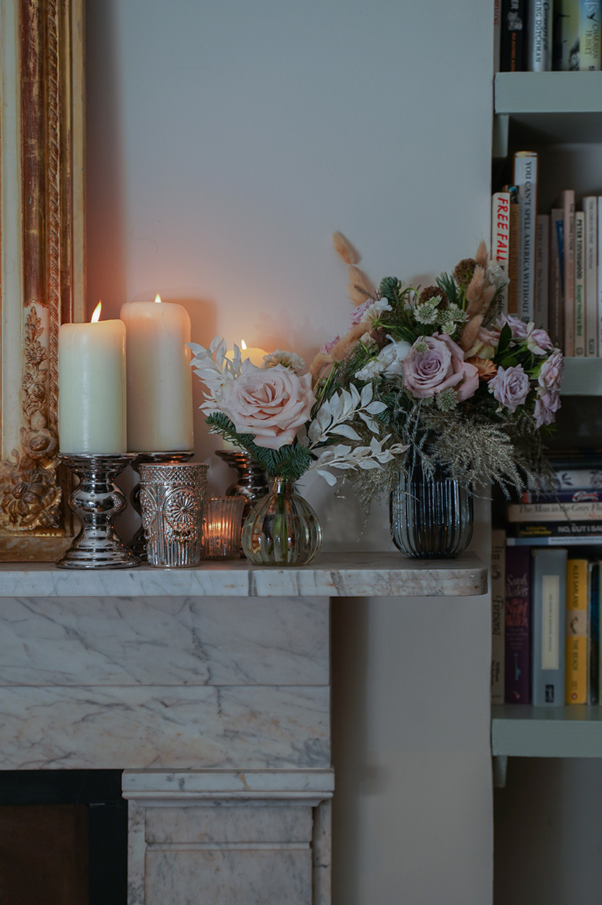 Mcqueens mantel florals for a white Christmas theme featured in Perfect Wedding magzine